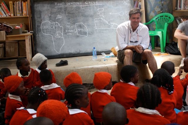 a photo of Prof. McAlear teaching the girls of the Kibera School about water