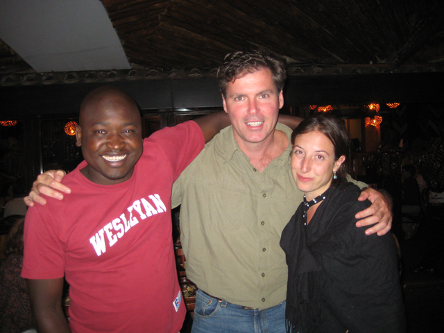 a photo of Prof. McAlear with Kibera founders Kenedy Odede and Jessica Posner