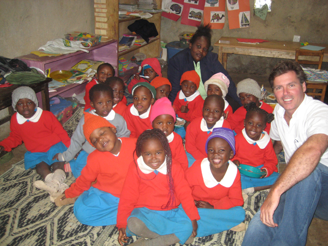 a photo of Prof. McAlear with Kibera Students