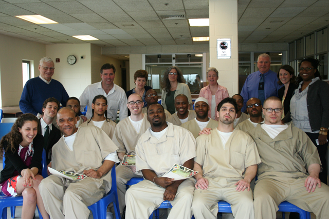 a photo of Prof. McAlear with inmates, faculty and administrators of the Wesleyan Prison Teaching Initiaive in its first year